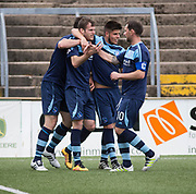 Danny Denholm is congratulated after heading home the opening goal during Forfar's 3-0 win over Clyde in SPFL League Two  at Station Park, Forfar, Photo: David Young<br /> <br />  - &copy; David Young - www.davidyoungphoto.co.uk - email: davidyoungphoto@gmail.com