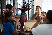 Ahmed Mohamed eats pizza with his family in Irving, Texas on July 12, 2016. (Cooper Neill for The Washington Post)