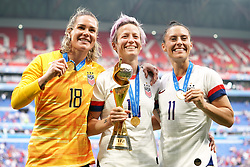 USA goalkeeper Ashlyn Harris (left), Megan Rapinoe and Ali Krieger (right) celebrate with the FIFA Women's World Cup Trophy after the final whistle