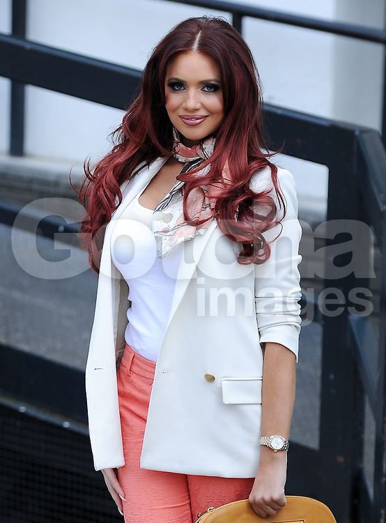 Red hair Amy Childs wearing a white blazer jacket and top with peach three quarter length trousers with matching orange shoes at ITV studios in London. UK. 23/04/2013<br />BYLINE MUST READ : GOTCHAIMAGES.COM<br /><br />Copyright by © Gotcha Images Ltd. All rights reserved.<br />Usage of this image is conditional upon the acceptance <br />of Gotcha Images Ltd, terms and conditions available at<br />www.gotchaimages.com