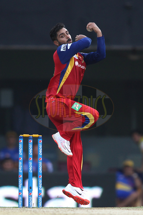 Iqbal Abdullah of the Royal Challengers Bangalore sends down a delivery during match 37 of the Pepsi IPL 2015 (Indian Premier League) between The Chennai Superkings and The Royal Challengers Bangalore held at the M. A. Chidambaram Stadium, Chennai Stadium in Chennai, India on the 4th May April 2015.<br /> <br /> Photo by:  Shaun Roy / SPORTZPICS / IPL