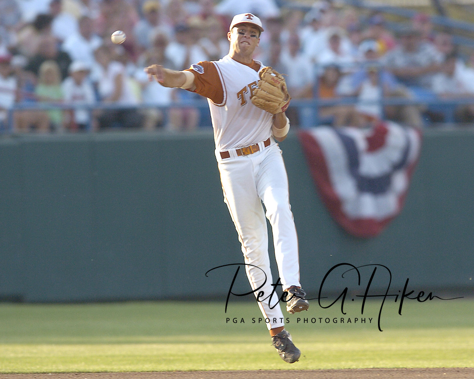 Texas shortstop Seth Johnston fires the ball to first in time to get the Tulane runner in the fifth inning.  Texas defeated Tulane 5-0 in the second round of the College World Series at Rosenblatt Stadium in Omaha, Nebraska on June 20, 2005.
