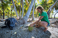 Patagonia ambassador Liz Clark trying to get some much needed coconut milk. French Polynesia