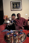 Ritual of tea for the guest at home of Mustapha Aouachi and Ahmed Masrouri in Nonantola, 1995. They live with their families in a council house...1995 Nonantola (Modena), il rito del tea nella casa popolare di Mustapha Aouachi e Ahmed Masrouri.