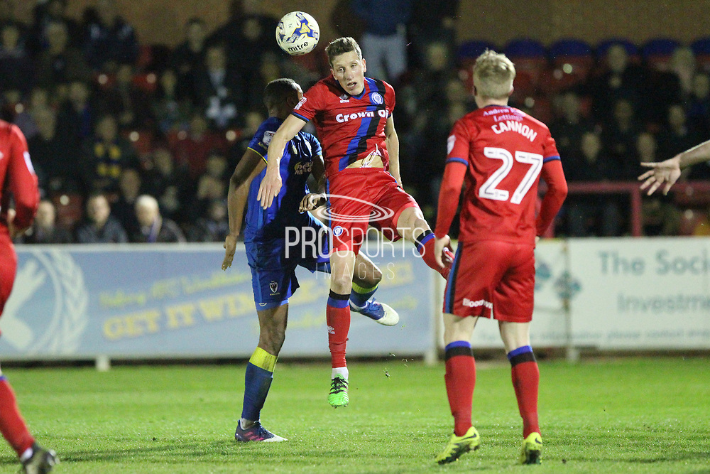 Jim McNulty wins a header during the EFL Sky Bet League 1 match between AFC Wimbledon and Rochdale at the Cherry Red Records Stadium, Kingston, England on 28 March 2017. Photo by Daniel Youngs.