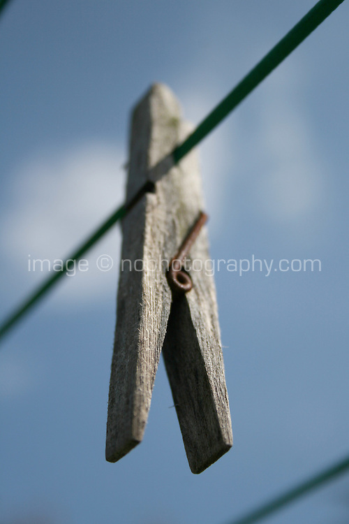 Old wooden clothes peg on washing line