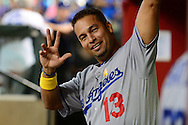 PHOENIX, AZ - SEPTEMBER 17:  Juan Castro #13 of the Los Angeles Dodgers waves to the camera in the dugout at Chase Field on September 17, 2016 in Phoenix, Arizona. The Dodgers won 6 - 2.  (Photo by Jennifer Stewart/Getty Images)