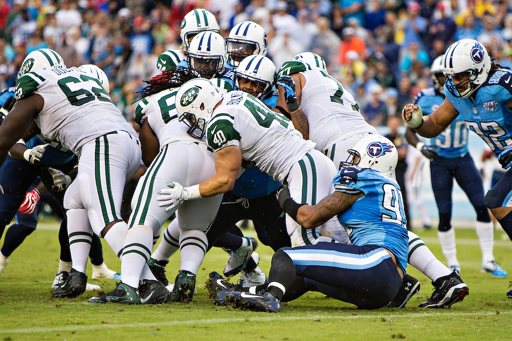 NASHVILLE, TN - SEPTEMBER 29:  Tommy Bohanon #40 of the New York Jets is tackled at the line of scrimmage by Derrick Morgan #91 of the Tennessee Titans at LP Field on September 29, 2013 in Nashville, Tennessee.  The Titans defeated the Jets 38-13.  (Photo by Wesley Hitt/Getty Images) *** Local Caption *** Tommy Bohanon; Derrick Morgan