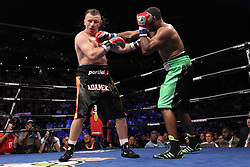 June 16, 2012; Newark, NJ, USA; Tomasz Adamek (Black trunks) and Eddie Chambers (Black/Green trunks) trade punches during their 12 round IBF North American Heavyweight title bout.