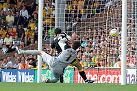 Photo: Ashley Pickering.<br /> Norwich City v Cardiff City. Coca Cola Championship. 01/09/2007.<br /> Peter Whittingham of Cardiff (no. 7) bundles the ball past Norwich goalie David Marshall to equalise