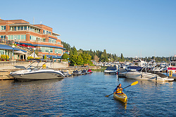 United States, Washington, Kirkland (near Seattle), Man kayaking in marina.  MR