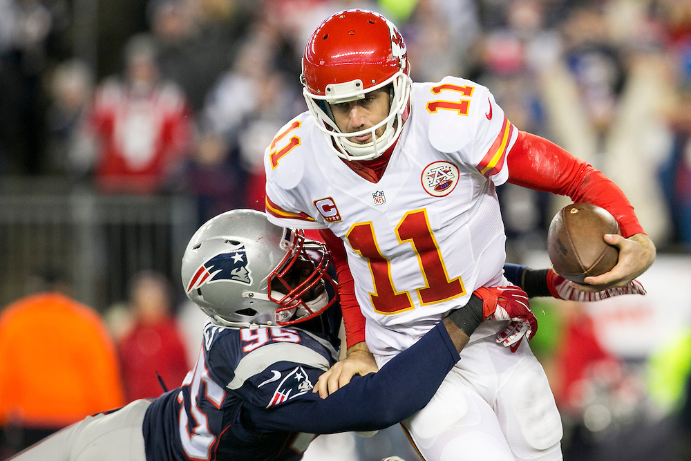 Kansas City Chiefs quarterback Alex Smith (11) slips a tackle from New England Patriots defensive end Chandler Jones (95) in the third quarter of the AFC Divisional Playoff game at Gillette Stadium in Foxborough, Massachusetts on January 16, 2016. The Patriots defeated the Chiefs, 27-20.    Photo by Kelvin Ma/ UPI