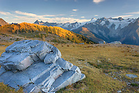 Boulders in Monica Meadows, the peaks of the Truce Group are in the distance, Purcell Mountains British Columbia Canada