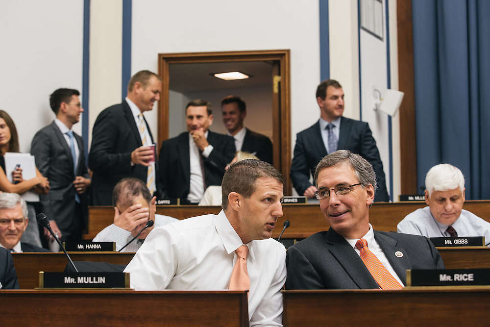 Congressman Markwayne Mullin talks with congressman Tom Rice of South Carolina during the Transportation and Infastructure committee's meeting on Sept. 19, 2013. During the meeting, the committee passed the Water Resources Reform and Development Act of 2013, a bipartisan bill.