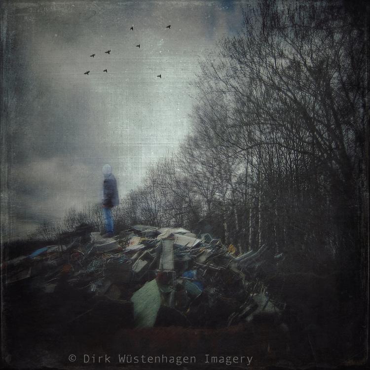 Man on a heap of junk - manipulated photograph
