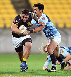 Wellington's Alex Fidow slips the tackle from Northland's Solomon Alaimalo in the Mitre 10 Semi Final Rugby match at Westpac Stadium, Wellington, New Zealand, Friday, October 20, 2017. Credit:SNPA / Ross Setford  **NO ARCHIVING**