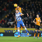 Hull City defender Curtis Davies (6) beats Brighton striker, Tomer Hemed (10) during the Sky Bet Championship match between Hull City and Brighton and Hove Albion at the KC Stadium, Kingston upon Hull, England on 16 February 2016.