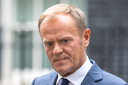 © Licensed to London News Pictures. 26/09/2017. London, UK. President of the European Council Donald Tusk leaves No 10 Downing Street and speaks to media following a meeting with British Prime Minister Theresa May. Photo credit : Tom Nicholson/LNP