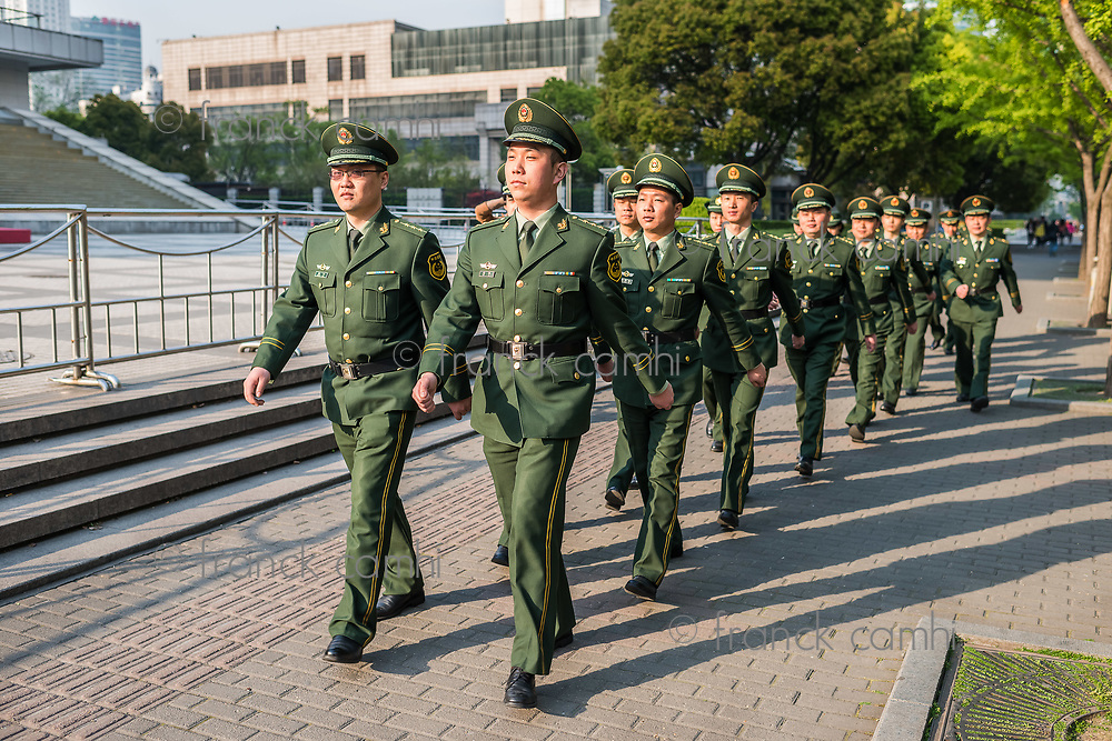 Shanghai, China - April 7, 2013: chinese red army soldiers marching in the street at the city of Shanghai in China on april 7th, 2013