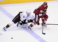 Mar. 2, 2013; Glendale, AZ, USA; Anaheim Ducks defensemen Ben Lovejoy  (6) defends Phoenix Coyotes center Steve Sullivan (26) in the second period at Jobing.com Arena. The Coyotes defeated the Ducks in a shootout 5-4. Mandatory Credit: Jennifer Stewart-USA TODAY Sports