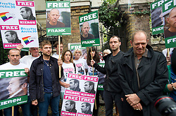 © London News Pictures. 05/10/2013.  London, UK. Musician Damon Albarn (centre) actor Jude Law (second right) and Paul Simonon, from The Clash (far right) at the demo.  Supporters of Greenpeace stage a demonstration outside the Russian Embassy in London to protest against the arrest of 30 Greenpeace activists, known as the 'Arctic 30' who charged with piracy by a Russian court, following a peaceful protest against Arctic oil drilling at an oil platform in the Pechora Sea. Photo credit Ben Cawthra/LNP