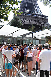 A bullet-proof glass wall is to be built around the base of the Eiffel Tower as part of a plan to provide extra protection against terrorist attacks at one of the worldÕs most famous landmarks, The 2.5-meter high wall will cost around 20 million euros and will replace the metal barriers set up as a temporary measure around the iconic tower in Paris, France on July 22, 2018. Photo by Alain Apaydin/ABACAPRESS.COM