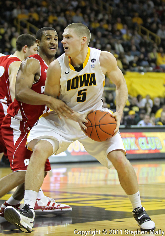 February 09 2011: Iowa Hawkeyes guard Matt Gatens (5) tries to drive around Wisconsin Badgers guard Jordan Taylor (11) during the second half of an NCAA college basketball game at Carver-Hawkeye Arena in Iowa City, Iowa on February 9, 2011. Wisconsin defeated Iowa 62-59.