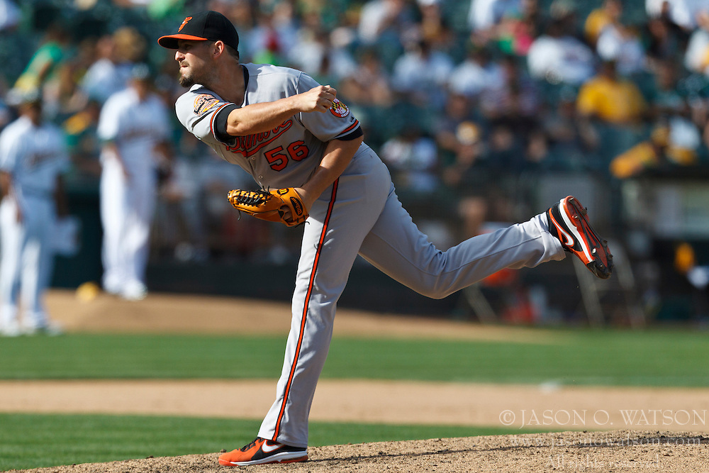 OAKLAND, CA - SEPTEMBER 16: Darren O'Day #56 of the Baltimore Orioles pitches against the Oakland Athletics during the eighth inning at O.co Coliseum on September 16, 2012 in Oakland, California. The Baltimore Orioles defeated the Oakland Athletics 9-5. (Photo by Jason O. Watson/Getty Images) *** Local Caption *** Darren O'Day