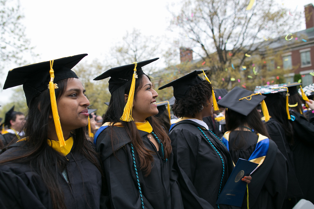 Graduates stand as degrees are conferred at the University of Rochester's Commencement ceremony in Rochester on Sunday, May 15, 2016.