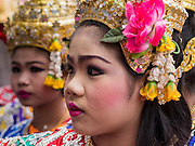 "29 SEPTEMBER 2012 - NAKORN NAYOK, THAILAND:   Thai dancers prepare to perform during observances of Ganesh Ustav at Wat Utthayan Ganesh, a temple dedicated to Ganesh in Nakorn Nayok, about three hours from Bangkok. Many Thai Buddhists incorporate Hindu elements, including worship of Ganesh into their spiritual life. Ganesha Chaturthi also known as Vinayaka Chaturthi, is the Hindu festival celebrated on the day of the re-birth of Lord Ganesha, the son of Shiva and Parvati. The festival, also known as Ganeshotsav (""festival of Ganesha"") is observed in the Hindu calendar month of Bhaadrapada, starting on the the fourth day of the waxing moon. The festival lasts for 10 days, ending on the fourteenth day of the waxing moon. Outside India, it is celebrated widely in Nepal and by Hindus in the United States, Canada, Mauritius, Singapore, Thailand, Cambodia, Burma , Fiji and Trinidad & Tobago.    PHOTO BY JACK KURTZ"