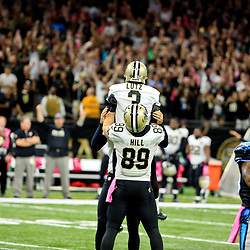 Oct 16, 2016; New Orleans, LA, USA; New Orleans Saints kicker Wil Lutz (3) is held up by tight end Josh Hill (89) after connecting on a 52-yard field goal with 16 seconds remaining during the fourth quarter of a game against the Carolina Panthers at the Mercedes-Benz Superdome. The Saints defeated the Panthers 41-38. Mandatory Credit: Derick E. Hingle-USA TODAY Sports