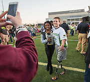 US Olympic gymnast Simone Biles poses for a photograph with a young player before the Wounded Warrior Amputee Football Team game against NFL Alumni, at Delmar Stadium, February 1, 2017.