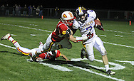 Central DeWitt's Jacob Kagemann (7) is pulled down by Marion's Ethan Herren (2) on a punt return during their second round playoff football game at Thomas Park Field in Marion on Monday, October 29, 2012.