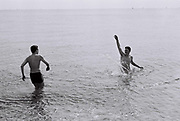 Boys playing in the sea, Shoreham, UK, 1986.
