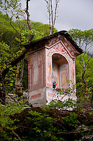 Ticino, Southern Switzerland. A pink Grotto hidden away in a chestnut forest in Valle Maggia.