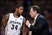 ST. LOUIS, MO - MARCH 26: Korie Lucious #34 of the Michigan State Spartans talks with head coach Tom Izzo at a break in the game against the Northern Iowa Panthers during the Midwest regional semi-final of the NCAA men's basketball tournament at the Edward Jones Dome on March 26, 2010 in St. Louis, Missouri. Michigan State advanced with a 59-52 win. (Photo by Joe Robbins)