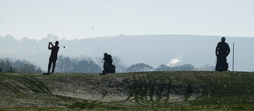© Licensed to London News Pictures.02/11/15<br /> Saltburn, UK. <br /> <br /> Golfers tee off into bright sunshine from Saltburn Golf Club has heavy fog shrouds the rest of the town and much of the country.<br /> <br /> Photo credit : Ian Forsyth/LNP