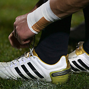 All Black Dan Carter laces up his boots during the New Zealand V Fiji Rugby Union test match at Carisbrook, Dunedin. New Zealand. 22nd July 2011. Photo Tim Clayton