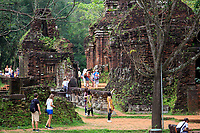 Tourists wander amongst the ruins of the ancient Hindu temple complex of My Son