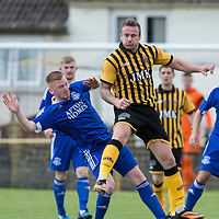 Picture by Christian Cooksey/CookseyPix.com.<br /> All rights reserved. For full terms and conditions see www.cookseypix.com<br /> <br /> Juniors - Auchinleck Talbot v Glenafton Athletic. Auchinleck's Mark Campbell clears from Glenafton's Chris Malone