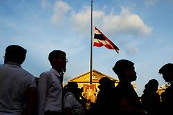 October 14, 2016 - Bangkok, BANGKOK, THAILAND - Thailand flag at half-mast outside the Grand Palace in Bangkok, Thailand. Thailand's King Bhumibol Adulyadej, the world's longest-reigning monarch, died at the age of 88 in Bangkok's Siriraj Hospital on Thursday after his 70-year reign. (Credit Image: © Kamal Sellehuddin via ZUMA Wire)