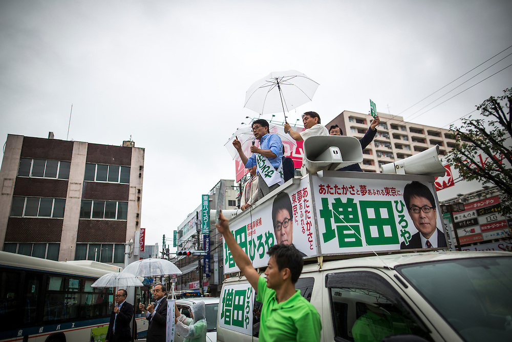 TOKYO, JAPAN - JULY 21 : Candidate Hiroya Masuda delivers a speech during a Tokyo Gubernatorial Election 2016 campaign rally at Kanamachi Station, Tokyo, Japan on Thursday, July 21, 2016. Tokyo residents will vote on July 31 for a new Tokyo Governor who will deal with issues related to hosting the Summer Tokyo Olympics and Paralympics in 2020. (Photo: Richard Atrero de Guzman/NUR Photo)