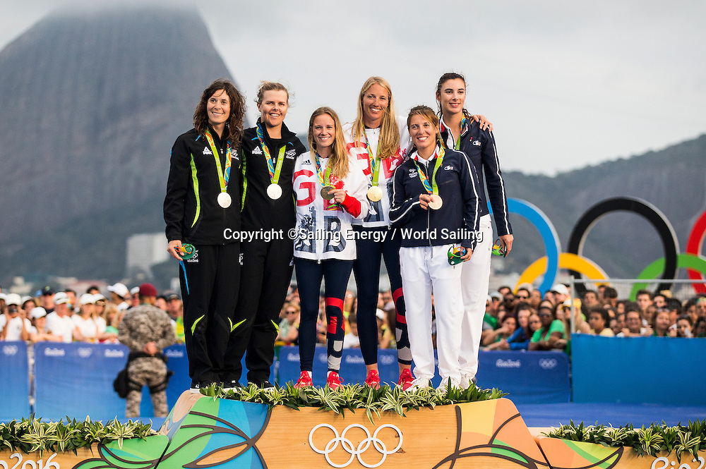 Jo Aleh and Polly Powrie of New Zealand on the podium winning Silver in the 470W class.<br /> The Rio 2016 Olympic Sailing Competition features 380 athletes from 66 nations, in 274 boats racing across ten Olympic disciplines. Racing runs from Monday 8 August through to Thursday 18 August 2016 with 217 male and 163 female sailors racing out of Marina da Gloria in Rio de Janeiro, Brazil. Sailing made its Olympic debut in 1900 and has been a mainstay at every Olympic Games since 1908. For more information or requests please contact Daniel Smith at World Sailing on marketing@sailing.org or phone +44 (0) 7771 542 131.