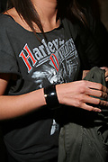 Girl wearing Harley Davidson t-shirt, T Bar, London.