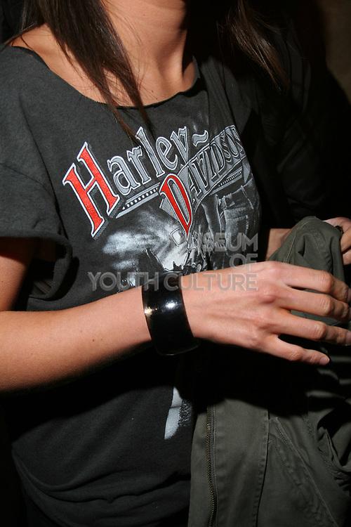 Girl wearing Harley Davidson t-shirt, T Bar, London.