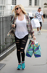 Singer Ellie Goulding and boyfriend Dougie Poynter back in London after their recent holiday in Ibiza. The Burn singer wearing a check shirt, white vest top and ripped jeans went to TopShop personal shopping with Dougie, before grabing a takeaway and wearing a baseball cap with the words Sex On The Beach... UK. 09/08/2014 <br />