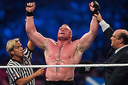 Brock Lesnar celebrates after defeating Dean Ambrose during WrestleMania on April 3, 2016 in Arlington, Texas.