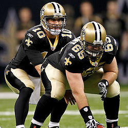 January 1, 2012; New Orleans, LA, USA; New Orleans Saints quarterback Chase Daniel (10) under center Matt Tennant (65) during the second half of a game against the Carolina Panthers at the Mercedes-Benz Superdome. The Saints defeated the Panthers 45-17. Mandatory Credit: Derick E. Hingle-US PRESSWIRE