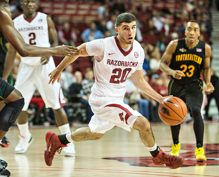 FAYETTEVILLE, AR - DECEMBER 3: Kikko Haydar #20 of the Arkansas Razorbacks dribbles the ball at the top of the key during a game against the SE Louisiana Lions at Bud Walton Arena on December 3, 2013 in Fayetteville, Arkansas.  The Razorbacks defeated the Lions 111-65.  (Photo by Wesley Hitt/Getty Images) *** Local Caption *** Kikko Haydar