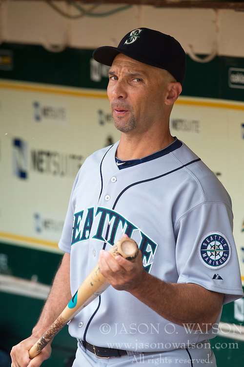 OAKLAND, CA - APRIL 04:  Raul Ibanez #28 of the Seattle Mariners stands in the dugout before the game against the Oakland Athletics at O.co Coliseum on April 4, 2013 in Oakland, California.  The Oakland Athletics defeated the Seattle Mariners 8-2. (Photo by Jason O. Watson/Getty Images) *** Local Caption *** Raul Ibanez